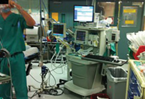 Figure 1: Photo of typical busy operating room displaying clutter, crowded conditions, and use of multiple pieces of equipment that increase the likelihood of pathogen transmission. Photo by L. S. Munoz-Price, MD, PhD.